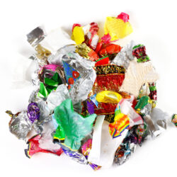 A,Bunch,Of,Candy,Wrappers,On,A,White,Background.,Closeup.