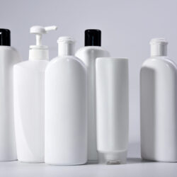 Six,White,Plastic,Bottles,With,Shampoo,And,Conditioner,And,Shower